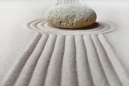 zen garden japanese garden zen stone with raked sand and round stone tranquility and balance ripples sand pattern Stock Photo - 9217091