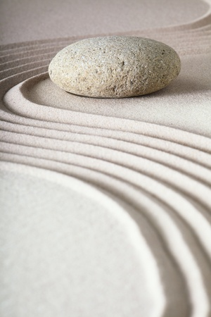zen garden japanese garden zen stone with raked sand and round stone tranquility and balance ripples sand pattern Stock Photo - 9217089