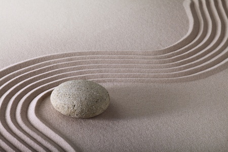 zen garden japanese garden zen stone with raked sand and round stone tranquility and balance ripples sand pattern Stock Photo - 9217092