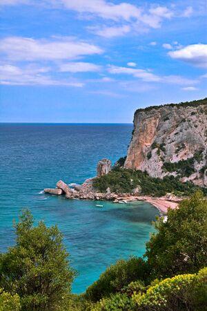 mediterranean sea: rocky shore Sardinia Italy blue sea and sky and high cliffs Stock Photo