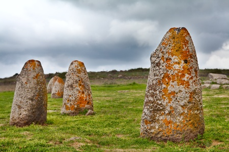 Merhir megalith stone in Sardinia Sardegna Italy big megalith stone standing in field archeological monument history