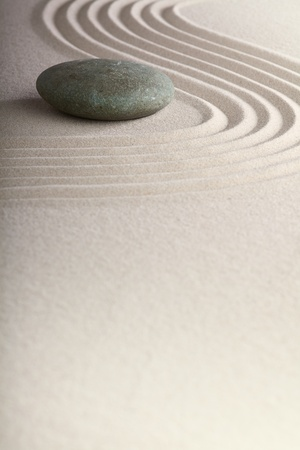 zen garden japanese garden zen stone with raked sand and round stone tranquility and balance ripples sand pattern Stock Photo - 9914395