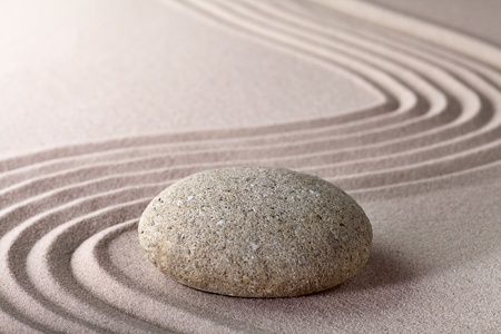 zen garden japanese garden zen stone with raked sand and round stone tranquility and balance ripples sand pattern Stock Photo - 9914407
