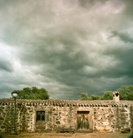 stormy clouds over ancient building dramatic sky and cloudscape Stock Photo - 9914397
