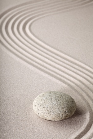 zen garden japanese garden zen stone with raked sand and round stone tranquility and balance ripples sand pattern Stock Photo - 10985735