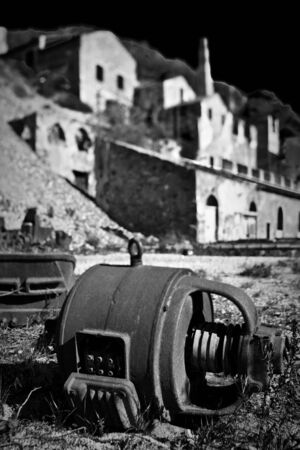 mine site: old abandoned mine site of 19the century hitorical factory and industrial plant in sardinia Italy, artistic image monochrome and with tilt shift lens