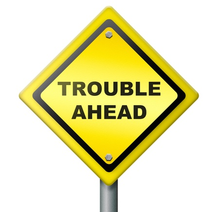 trouble ahead, signpost warning for bad times and misfortune, alarm for hazardous future, text on road sign, isolated Stock Photo