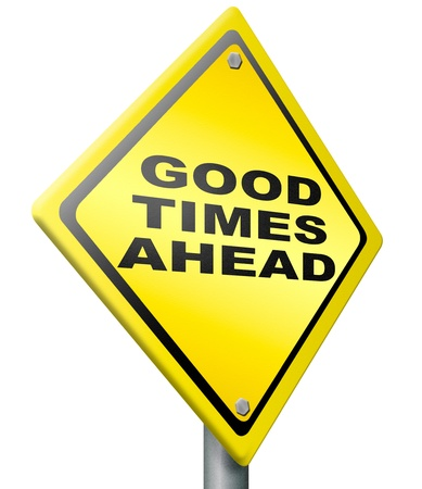 good mood: good times ahead optimistic yellow road sign being positive and optimism for a bright future and great time Stock Photo