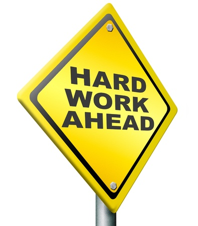 hard work ahead yellow warning road sign, tough job be ambitous even if you hace a difficult challenging task with impact to finish. ambition to meet the challenge icon. Stock Photo - 11846742