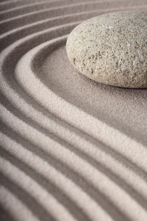 Japanes meditation spa garden pattern of sand and stones with curved lines for balance and relaxation zen buddhism photo