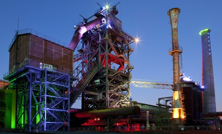 steel industry blast furnace factory or plant abandoned old industrial architecture at night with colored lights Landschaftspark Duisburg, Germany Stock Photo - 12385896