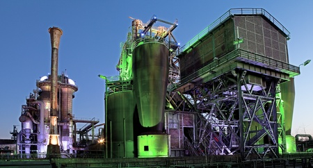 steel industry blast furnace factory or plant abandoned oldindustrial architecture at night with colored lights Landschaftspark Duisburg, Germany
