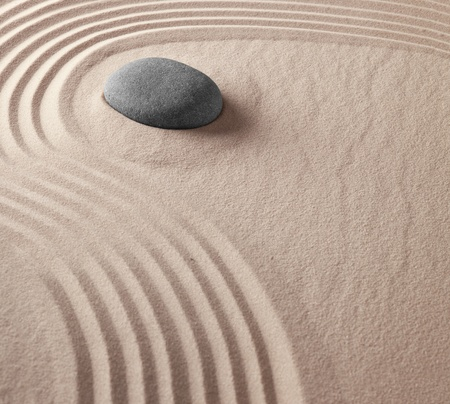zen buddhism spiritual japanese rock garden abstract harmony and balance concept for purity concentration meditation and spa relaxation sand and stone photo