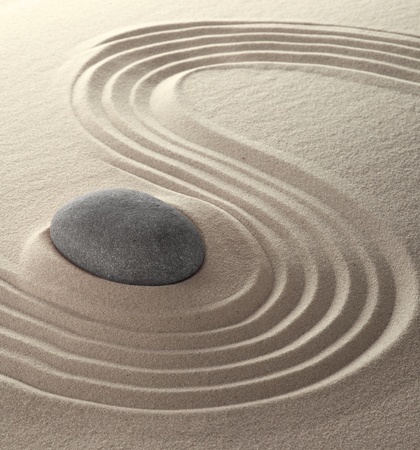 zen stones: spa relaxation garden japanese culture concept for concentration and purity sand and stones background