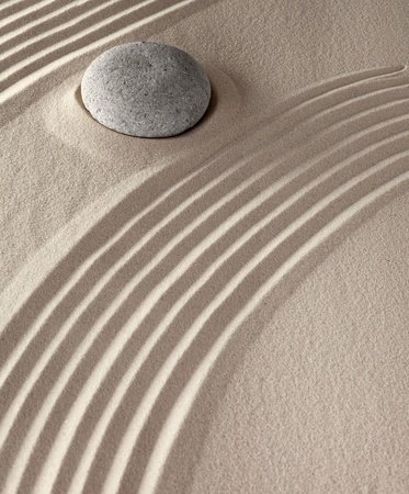 spiritual meditation stones in Japanese Buddhism zen garden rocks and sand symbol for concentration and purity photo