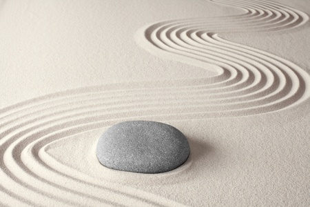 spiritual zen meditation background in Japanese rock garden concept for harmony balance simplicity sand and pebble tao or Buddhism photo