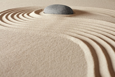 buddhism: zen buddhism meditation and relaxation japanese garden concept for balance harmony and purity pebbel and sand in pattern Stock Photo