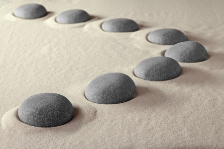 the stepping: rocks in sand pettern in curve line round stone nature background stepping stones