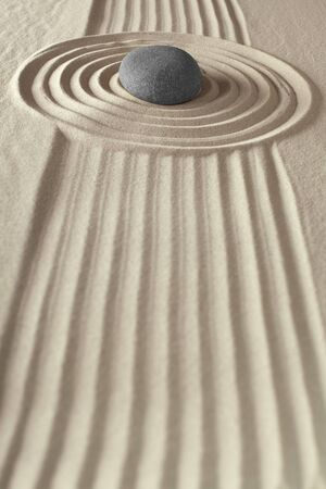 meditation rock in japanese zen garden sand and stone pattern nature in harmony and simplicity focus and concentration of energy circle photo