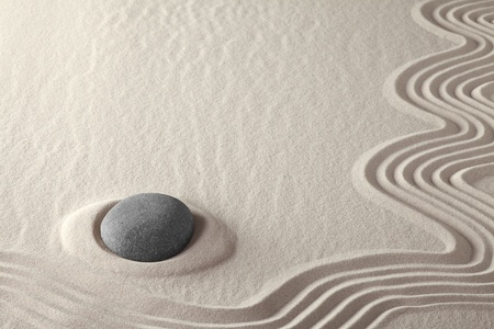 meditation stone japanese zen garden spa welness background concept for purity harmony balance simplicity relaxation rock and sand pattern photo