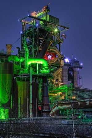 steel industry blast furnace factory or plant abandoned old industrial architecture at night with colored lights Landschaftspark Duisburg, Germany photo