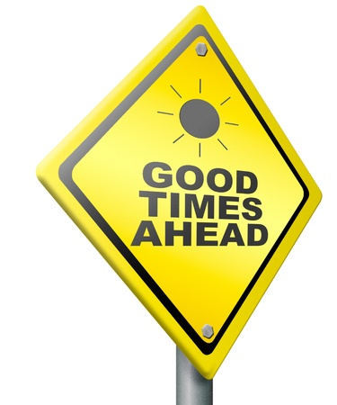 good times: good times ahead optimistic yellow road sign being positive and optimism for a bright future and great time Stock Photo