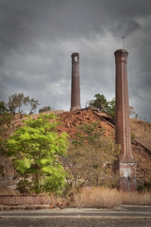 industrial heritage: chimney at old abbandoned mining site in Australia, build in red bricks industrial heritage industry in decay