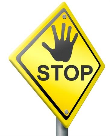 halt: stop warning sign hand gesture on yellow road sign halt text Stock Photo