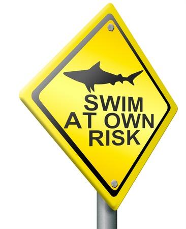 swimm: swim at own risk shark attack alert dangerous animal in the sea water yellow road sign
