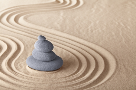 sand stone: zen garden meditation stone for meditation and relaxation conceptual for simplicity harmony purity and balance background with copy space Stock Photo