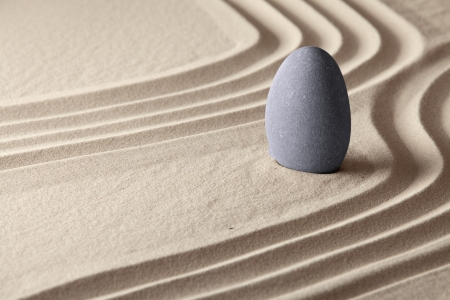 serenity: meditation and concentration for spiritual balance concept of Japanese zen garden sand and stone patterns background Stock Photo