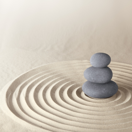 Japanese zen garden meditation stone for concentration and relaxation sand and rock for harmony and balance in pure simplicity photo