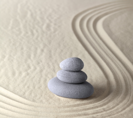 spiritual energy: harmony and balance in zen garden where sand and stones concentrate energy for meditation and relaxation spiritual and spa wellness background peaceful serene scene Stock Photo