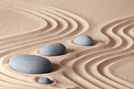 zen garden stones in row pattern in sand and rocks for relaxation and concentration during meditation photo
