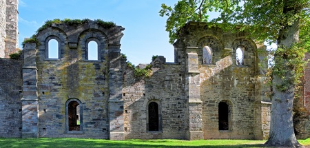 abbey ruins Villers la ville Belgium gothic buildings abandoned years ago spooky facades with face like features scary creepy haunted medieval place church building ghost house photo