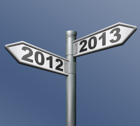 2012 2013 new year road sign arrow pointing towards the future photo