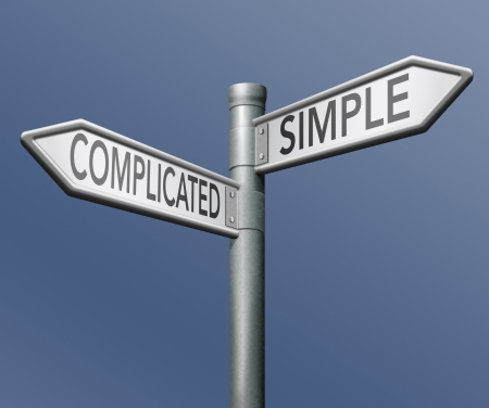 complication: complicated or simple the easy or the hard way roadsign arrow on blue background crossroads decisive choice challenge making choice stand out from crowd taking risk adventure character test