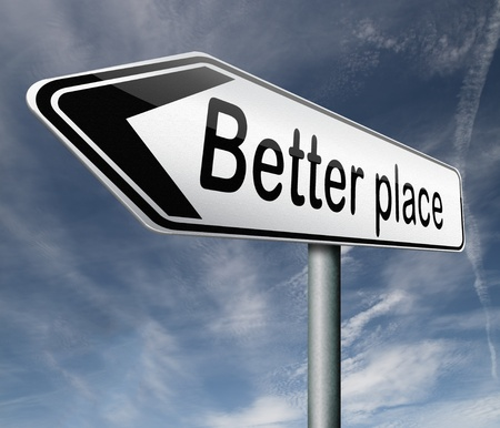 better: a better place pointing towards change and progress to improve the world road sign arrow Stock Photo
