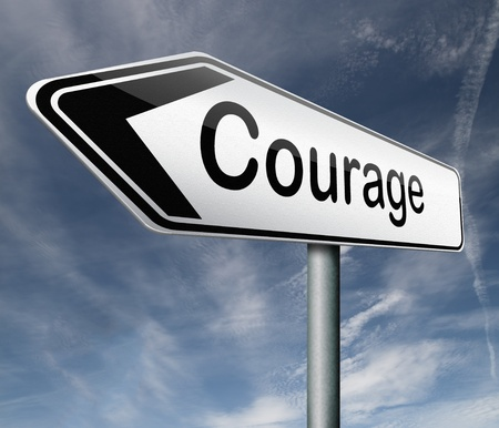 courage roadsign arrow pointing towards bravery the ability to confront fear pain danger uncertainty and intimidation Stock Photo - 16575582