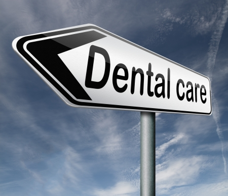 dentistry: dental careoral hygiene or surgery for healthy teeth without caries but with a beautiful smile road sign with text Stock Photo