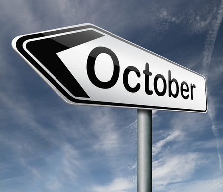 October pointing to next month of the year autumn road sign arrow Stock Photo - 16575417