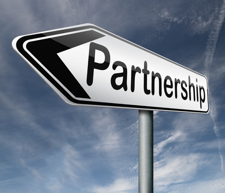 cooperate: partnership partners in crime or business partner cooperate pact Stock Photo
