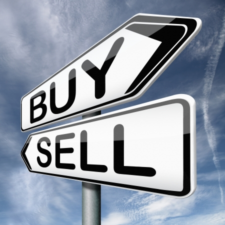 buying stock: buy or sell buying or selling on stock market road sign text