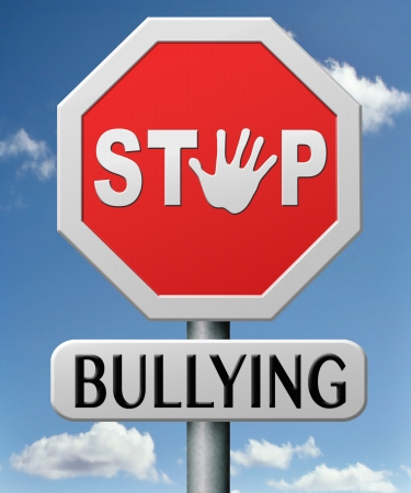 bully: stop bullying at school or at work stopping an online internet bully Stock Photo