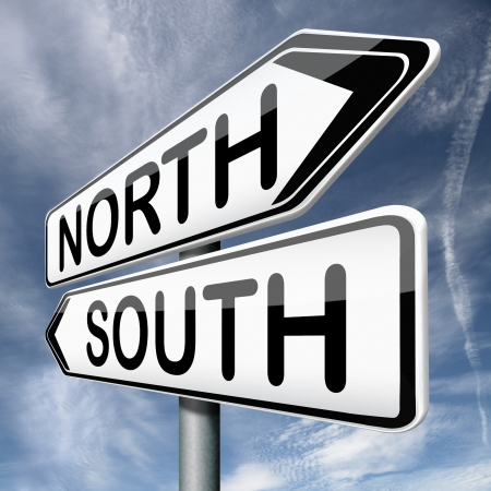 opposites: north or south warm or cold  road sign on blue background opposite direction opposites contrast choice crossroads