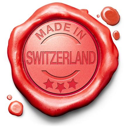 control de calidad: hecho en Suiza comprar producto original aut�ntico sello de calidad sello de cera roja sello suizo comprar locales Foto de archivo
