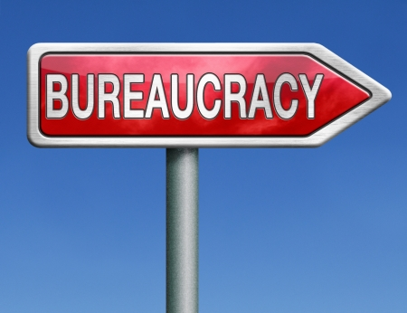 bureaucracy paper work business and public administration of official files and documents  photo
