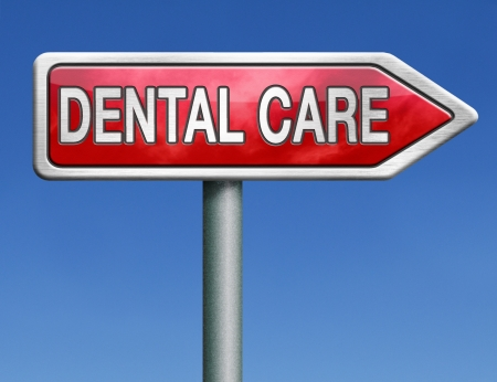 dentalcare: dental careoral hygiene or surgery for healthy teeth without caries but with a beautiful smile road sign with text Stock Photo