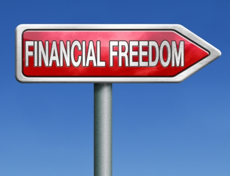 financial freedom or liberty independance independant independancy rich and wealthy self sufficiency red road sign arrow Stock Photo - 20125573