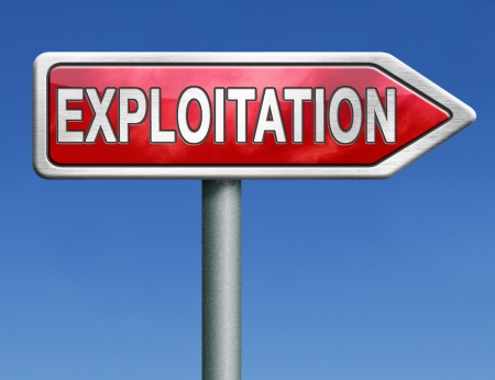 exploitation: exploitation of natural resources exploit worker or farmer in thirth world or exploitment of the earth red road sign arrow with text word concept Stock Photo
